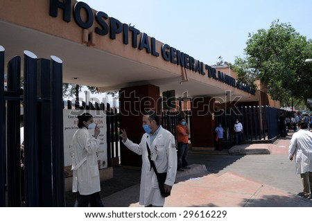 MEXICO CITY- APR 28: Doctors greet each other in front of the General Hospital Dr. Manuel Gea Gonzalez in Mexico City, the epicenter of the global H1N1 swine flu outbreak April 28, 2009 in Mexico City