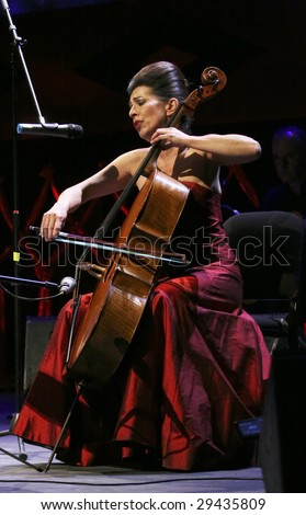 MEXICO CITY - APRIL 21 2009: Cellist Jimena Gimenez Cacho performs during Chavela Vargas' 90th Aniversary homage at the Teatro de La Ciudad de Mexico on April 21, 2009 in Mexico City, Mexico. - stock photo