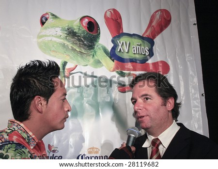 MEXICO CITY- APRIL 6 : Mr. Agustin Pumarejo (R) at Festival Music for the Earth Music Fest press conference at El Lunario Concert Hall April 6, 2009 in Mexico City. - stock photo