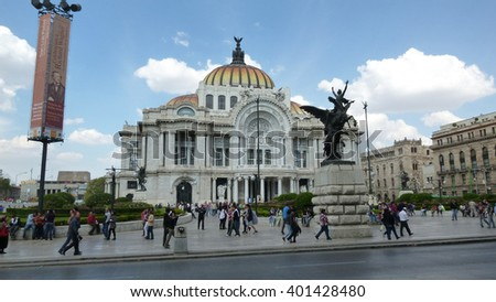 Mexico City, D.F, Mexico - December 2012: View of the Palacio de Bellas Artes and in the historic center. Locals and visitors in front of it and walking on the sidewalk.