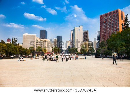 MEXICO CITY - DEC 2, 2015; People on Plaza  De La Republica in Tabacalera on Dec 2, 2015 in Mexico City, Mexico. It is a largest city in the Americas. - stock photo