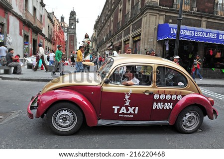 MEXICO CITY - FEB 23 2010: Classic Mexican Volkswagen Sedan taxi in Mexico City, Mexico.Mexico have 100,000 taxis,making it the biggest taxicabs fleet in the world. - stock photo