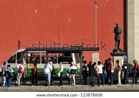 MEXICO CITY-FEB 25:Line of Mexican people in public transportation station in Mexico City on February 25 2010.It's the second busiest publicly owned transit system in North America after New York City - stock photo