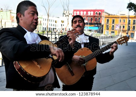 MEXICO CITY - FEB 24 :Mariachi band play mexican music on February 24 2010 in Garibaldi Square in Mexico City, Mexico.The Plaza is best known as the Mexico City home of mariachi music. - stock photo