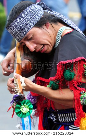 MEXICO CITY - FEB 23 2010:Mexican man play traditional music.Modern Mexicans are a unique blend of many ancient civilizations: Olmec, Zapotec, Toltec, Maya, Aztec, Inca, African, French and Spanish - stock photo