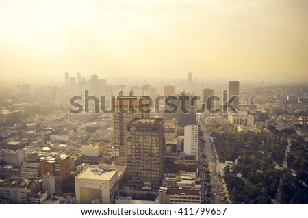 Mexico city industrial part covered in haze on sunset seen from the Latin American Tower, Mexico