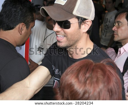 "MEXICO CITY - MARCH 28: Singer Enrique Iglesias attends a photo call to promote his album ""Greatest Hits"" and tour at the Departamento Coca Cola on March 28, 2009 in Mexico City. - stock photo"