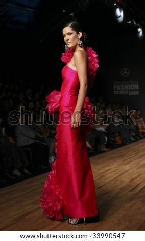 MEXICO CITY - MAY 21: A model walks the runway wearing Sebastian y Marialuisa Autumn/Winter 2009 during Mercedes-Benz Fashion Mexico Autum/Winter 2009 May 21, 2009 in Mexico City. - stock photo