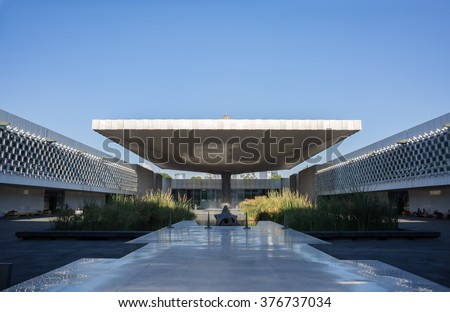 MEXICO CITY, MEXICO - April 24, 2015: The plaza of the National Museum of Anthropology of Mexico. In the middle is a vast square concrete umbrella of cascading water.