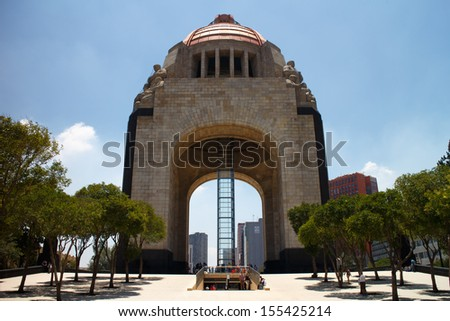 MEXICO CITY, MEXICO -  JUL, 27, 2013: Monument commemorating the Mexican Revolution. Designed in an eclectic Art Deco and Mexican socialist realism style. Mexico City, Mexico on Jul, 27, 2013. - stock photo