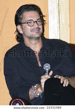"MEXICO CITY, MEXICO - JUNE 3: Singer Ricardo Arjona attends The ""5th Floor Tour"" press conference at Presidente Intercontinental Hotel Mexico in Mexico City,Mexico. June 3 2009. - stock photo"
