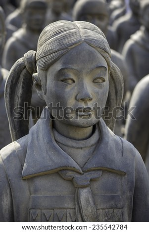 MEXICO CITY, MEXICO -  NOV, 29, 2014: French artist Prune Nourry sculpted 8 life-size Terracotta Girls modeled after Chinese orphan girls. Diego Rivera museum, Mexico City, Mexico on Nov, 29, 2014. - stock photo