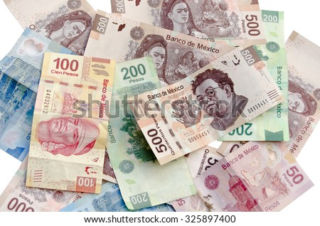 MEXICO CITY / MEXICO - SEPTEMBER 14 2015: Mexican Pesos exchange rate, assorted bills cash pile background - stock photo