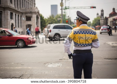 MEXICO CITY - SEP 07 2015: Traffic cop checking the traffic in mexico city. - stock photo