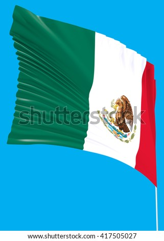 Mexico flag on the wind with a blue sky
