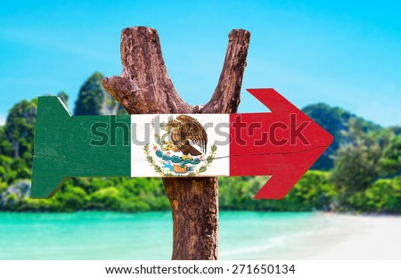Mexico Flag wooden sign with beach background - stock photo
