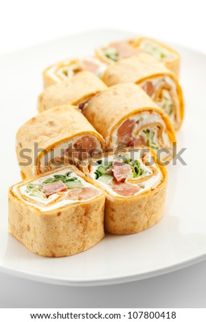 Mexico Maki Sushi - Roll made of Smoked Salmon, Cream Cheese, Cucumber and Spring Onion inside. Tortilla outside - stock photo
