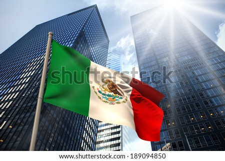 Mexico national flag against low angle view of skyscrapers - stock photo