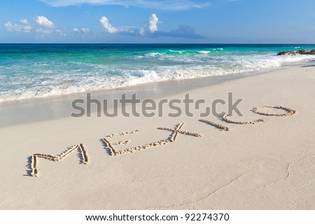Mexico sign on the beach of Caribbean Sea in Mexico - stock photo