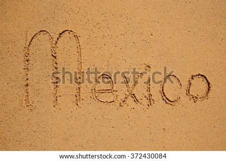 Mexico sign written on the beach sand - stock photo