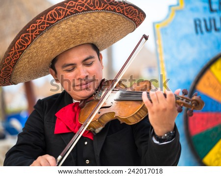 MEXICO TULUM 06 MAY 2013  Mariachi man playing violin 06.May.2015 Editorial only