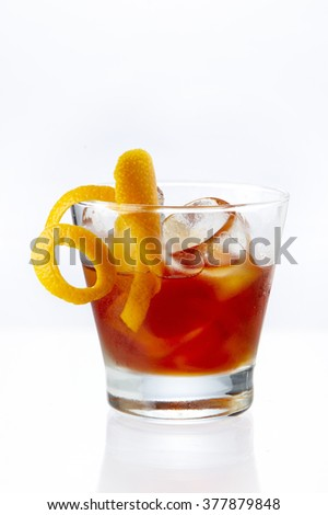 MexiMilan Affair cocktail garnish with orange zest twist served in an old-fashioned glass with crushed ice - stock photo