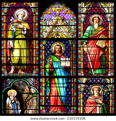 MEZE, FRANCE -July 23, 2014: Photo collage of Scenes of the Bible. Stained glass window in the Cathedral of Meze, on July 23, 2014 in Meze, south of France - stock photo