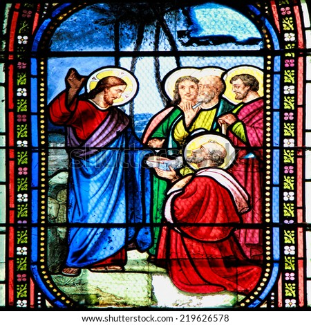 MEZE, FRANCE - July 23, 2014: Scene of the Bible. Stained glass window in the Cathedral of Meze, on July 23, 2014 in Meze, south of France - stock photo