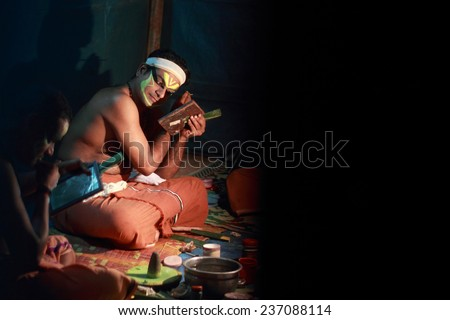 MEZHUVELII, KERALA - MAR 01: An unidentified Kathakali artists do make up before performance  during the Shivarathri festival of  the Shiva temple on March 01, 2014 in Mezhuveli, Kerala, India.  - stock photo