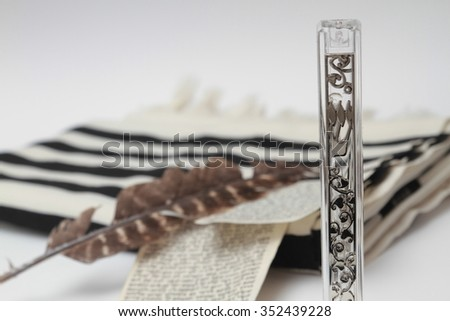 mezuza's cases, tallit, Quill and parchment isolated over white background Symbol of Judaism - stock photo