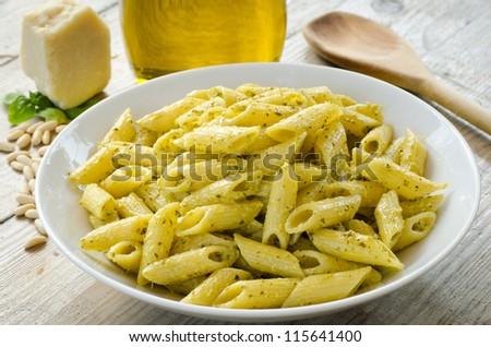 Mezze penne pasta with pesto sauce - stock photo