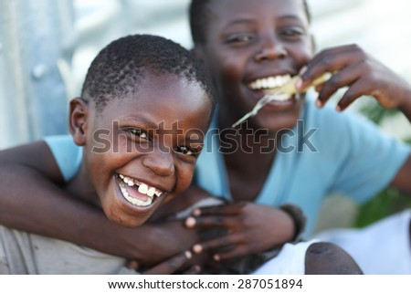 MFANGANO ISLAND - KENYA - DECEMBER 21, 2014: Unidentified orphans in an orphan boarding school on December 21, 2014 on Mfangano Island, Kenya. Many children lost their parents because they died of HIV - stock photo