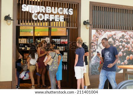 MIAMI - AUGUST 16: People lining up at the Aventura Mall Starbucks with lines going out the door August 16, 2014 in Miami USA.  - stock photo