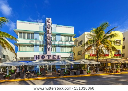 MIAMI - AUGUST 5: The Colony hotel located at 736 Ocean Drive and built in the 1930's is the most photographed hotel in South Beach August 5, 2013 in Miami, Florida. - stock photo