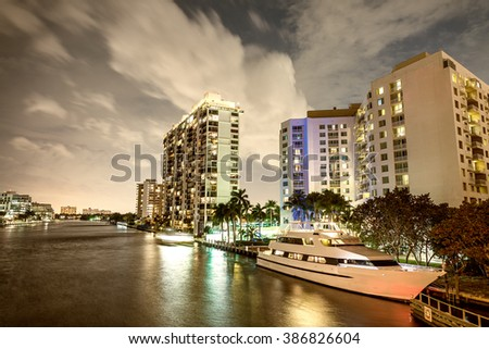 Miami Beach at night. Beautiful buildings reflections.