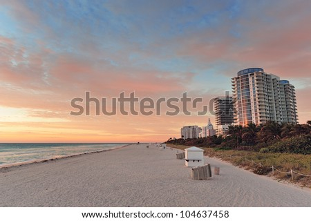 Miami Beach at sunset with colorful clouds - stock photo