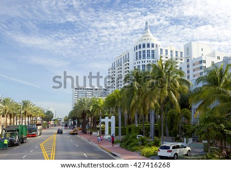 Miami Beach. Collins Avenue. Collins Avenue runs from South to North Miami beach, parallel to the Atlantic coast, passes through many famous areas of the city and lavishly luxurious hotels, boutiques. - stock photo