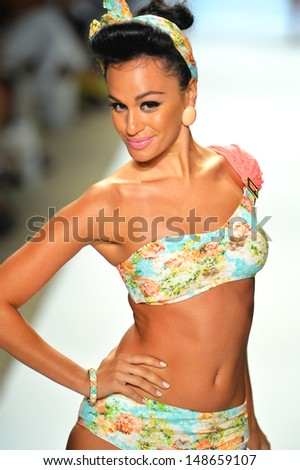 MIAMI BEACH, FL - JULY 20: A model walks the runway at the Nicolita show during Mercedes-Benz Fashion Week Swim 2014 at the Raleigh on July 20, 2013 in Miami Beach, Florida.