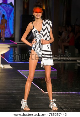 MIAMI BEACH, FL - JULY 23, 2017: A model walks the runway wearing Seafolly 2018 Collection during Miami Swim Fashion Week