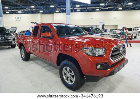 MIAMI BEACH, FL, USA - NOVEMBER 6, 2015:  Toyota Tacoma on display during the 2015 Miami International Auto Show at the Miami Beach Convention Center in downtown Miami Beach.