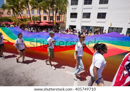 MIAMI BEACH, FLORIDA, APR 2016: The 8th Annual Miami Beach Gay Pride Parade, along Ocean Drive in Miami Beach, Florida. Lesbian, gay, bi, and transgender celebrate diversity. Editorial image only. - stock photo