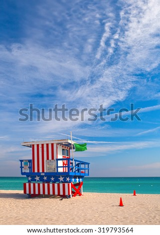 Miami Beach Florida, Art Deco lifeguard house painted as the American Flag. Miami Beach is famous travel destination for nightlife, beautiful beaches and sunny weather