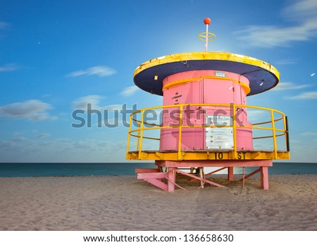 Miami Beach Florida, colorful lifeguard house in typical Art Deco architectural style, long night exposure under moonlight