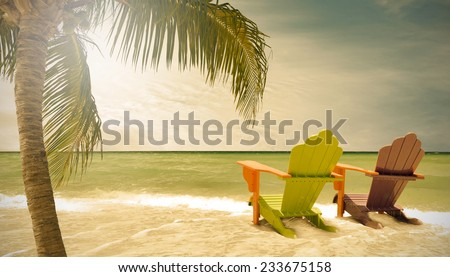 Miami Beach Florida, lounge chairs and palm trees by the ocean, filtered desaturated vintage looking landscape - stock photo