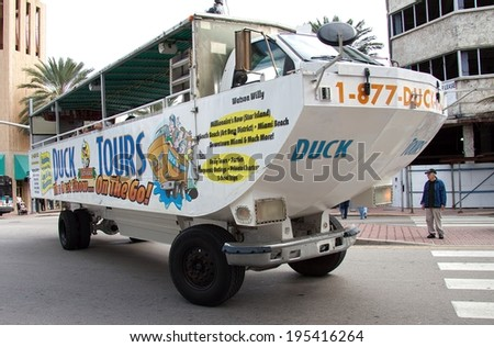 "MIAMI BEACH, FLORIDA - March 02, 2010: Famous Miami Beach ""Duck Tour"". This tourist attraction tours famous Miami landmarks with an amphibious vehicle that can operate both as a bus and as a boat."