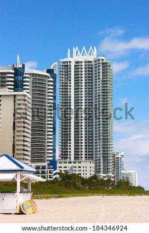 Miami Beach, Florida, modern architecture buildings along the beach. Beach and resort buildings on a bright sunny day. - stock photo