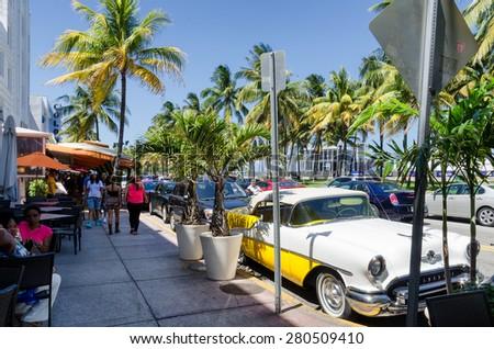 Miami Beach, Florida, US - May 17, 2015 -  old retro car parked along ocean dr. street in south Miami beach - stock photo