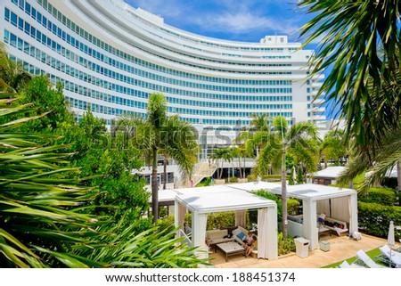 MIAMI BEACH, FLORIDA USA  - APRIL 21, 2013: The historic Fontainebleau Hotel by architect Morris Lapidus on Miami Beach is a popular international tourist destination. - stock photo