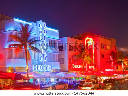 MIAMI BEACH, FLORIDA, USA-AUGUST 9:  Art Deco hotels and restaurants at night on Ocean Drive on August 9, 2013, world famous destination for nightlife, beautiful weather and pristine beaches  - stock photo