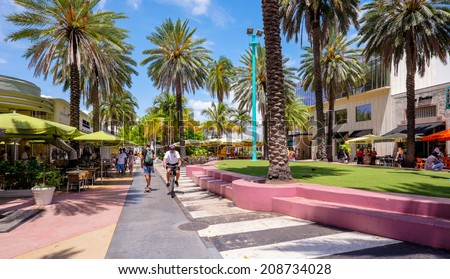 Miami Beach, Florida USA - August 1, 2014: The beautiful Lincoln Road Mall in Miami Beach is a popular international travel destination with palm trees and art deco architecture. - stock photo